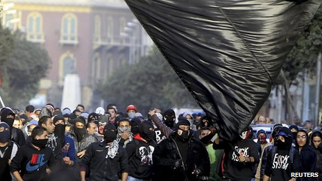Members of the Black Bloc are seen during the protest in Tahrir Square in Cairo on 25 January