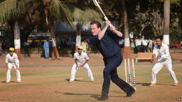 Prime Minister David Cameron plays cricket in India
