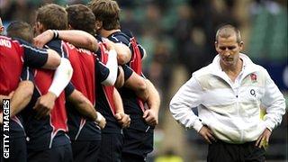 Stuart Lancaster listens on as the players speak pre-match