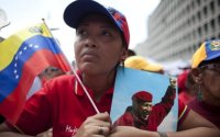 """Supporters of Hugo Chavez attend a rally on 27 February commemorating the violent street protests of 1989 known as the """"Caracazo"""""""