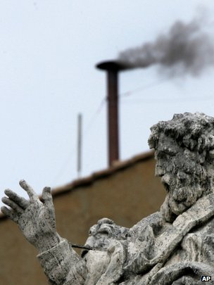 Black smoke billows from the chimney atop the Sistine Chapel at the Vatican, indicating that the cardinals gathered in the Conclave have not yet chosen a new pope, file pic from 19 April 2005