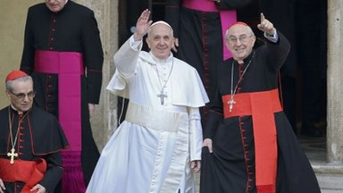 Pope Francis waves from the steps of the Santa Maria Maggiore Basilica in Rome, 14 March 2013