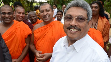 Sri Lanka's Defence Secretary Gotabhaya Rajapakse (R) stands near Buddhist monks at the opening of a Buddhist Education and Cultural Centre in the southern district of Galle March 9, 2013. The centre is linked to the Bodu Bala Sena (BBS)