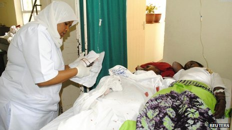 People wounded by the blast receive treatment at a hospital in the northern Tanzanian town of Arusha on 5 May 2013