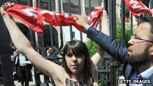 A Femen protester takes part in a demonstration in support of activist Amina Tyler outside a courthouse in Tunisia