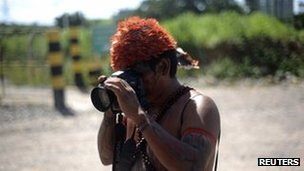 An indigenous Brazilian with a camera at a protest against the Belo Monte dam on 6 May 2013