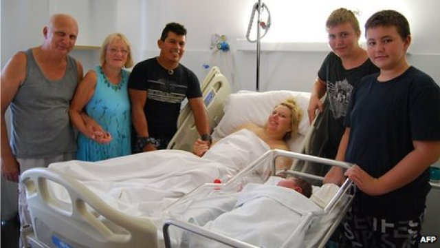 Maxime Marin with her child Maria Lorena - Spain's biggest baby born naturally - with their family in hospital in Spain