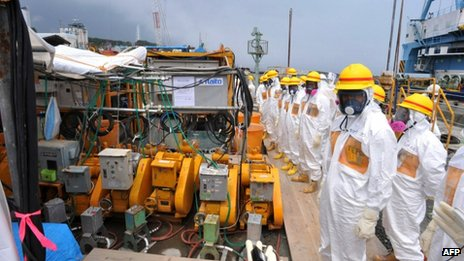 Local government officials and nuclear experts inspect a facility to prevent seeping of contamination water into the sea at Tokyo Electric Power's Fukushima Dai-ichi nuclear plant in Okuma, Fukushima prefecture. Japan, 6 August 2013