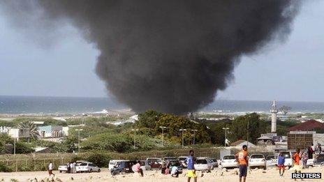 "Dark smoke rises above Abdule Airport in Somalia""s capital Mogadishu 9 August, 2013."