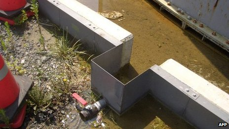 This hand out picture taken by Tokyo Electric Power Co (TEPCO) on 19 August 2013 shows contaminated water which leaked from a water tank at Fukushima nuclear power plant