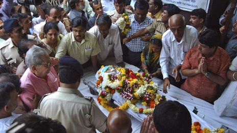 In this Tuesday, Aug. 20, 2013 photo, people pay last respects to anti-superstition activist Narendra Dabholkar who was killed in Pune, India