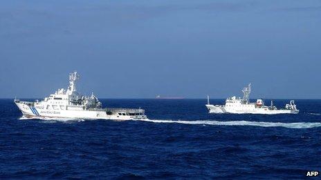 Japan's coast guard ship (left) sails along China's marine surveillance near the disputed islands in the East China Sea. File photo