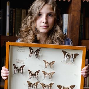 Athena Martin with some of the butterflies in the collection