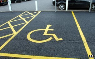 Wheelchair icon in parking bay