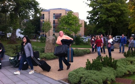 parents and students carrying luggage at Sheffield University