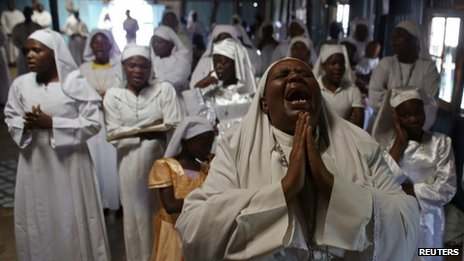 A woman prays inside a church during a prayer for victims of Westgate shopping centre - Nairobi 29 September 2013