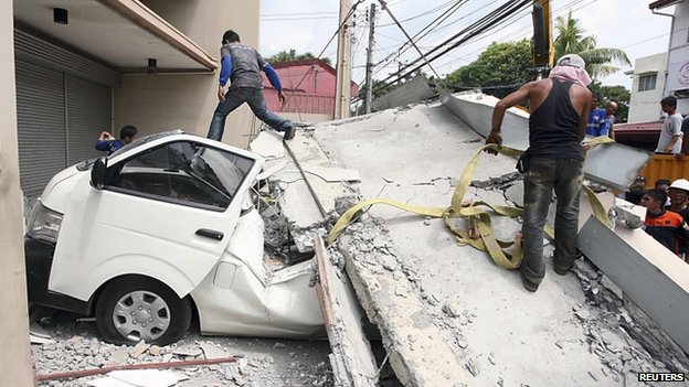 Image of a building wall that collapsed on a van in Cebu, Philippines