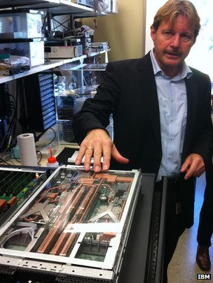 IBM's Bruno Michel with liquid cooled Aquasar server