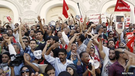 Protesters shout slogans during a demonstration in central Tunis to call for the departure of the Islamist-led ruling coalition