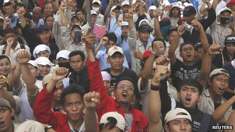 Workers shout slogans during a protest at the Jakarta Industrial Estate