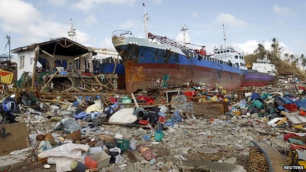 Cargo ships washed ashore are seen four days after super typhoon Haiyan hit Anibong town, Tacloban city, central Philippines November 11, 2013.