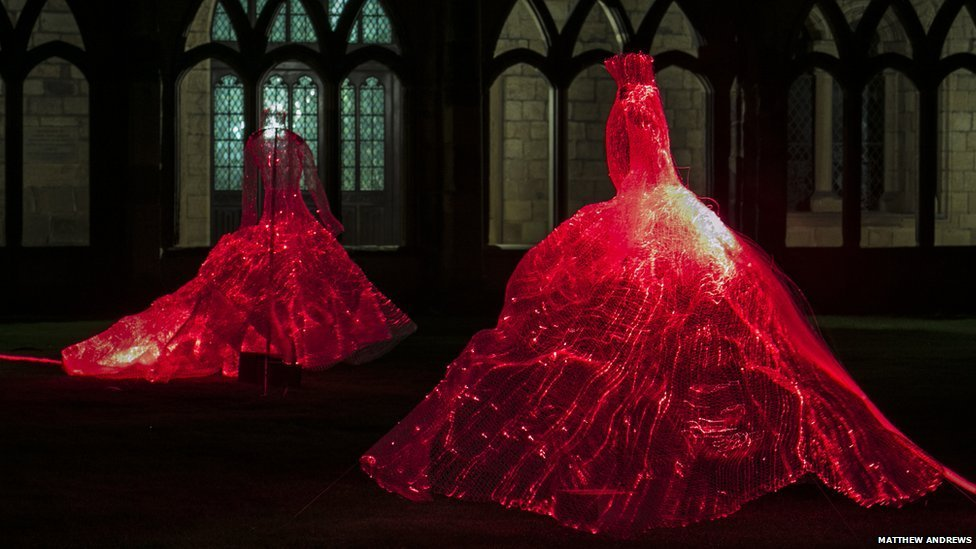 Illuminated fibre-optic dresses (currently red).