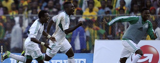 Nigeria's Eddy Onazi, Emmanuel Emenike and James Okwuosa celebrate a goal against Ethiopia