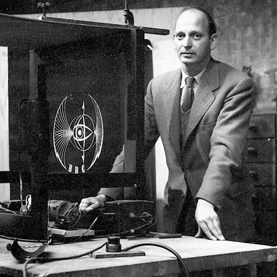 Abram Games with a model he made to film the TV logo he designed for the BBC