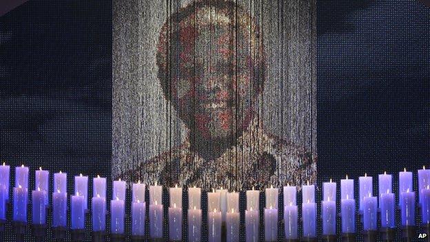 Candles illuminate a portrait of Nelson Mandela in Qunu. Photo: 15 December 2013