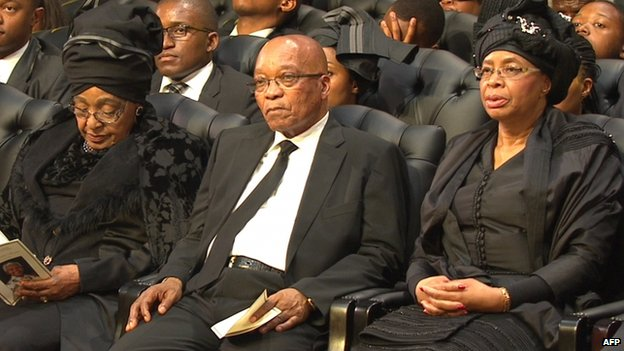 President Jacob Zuma sat between Nelson Mandela's widow Graca Machel and his ex-wife Winnie Madikizela-Mandela