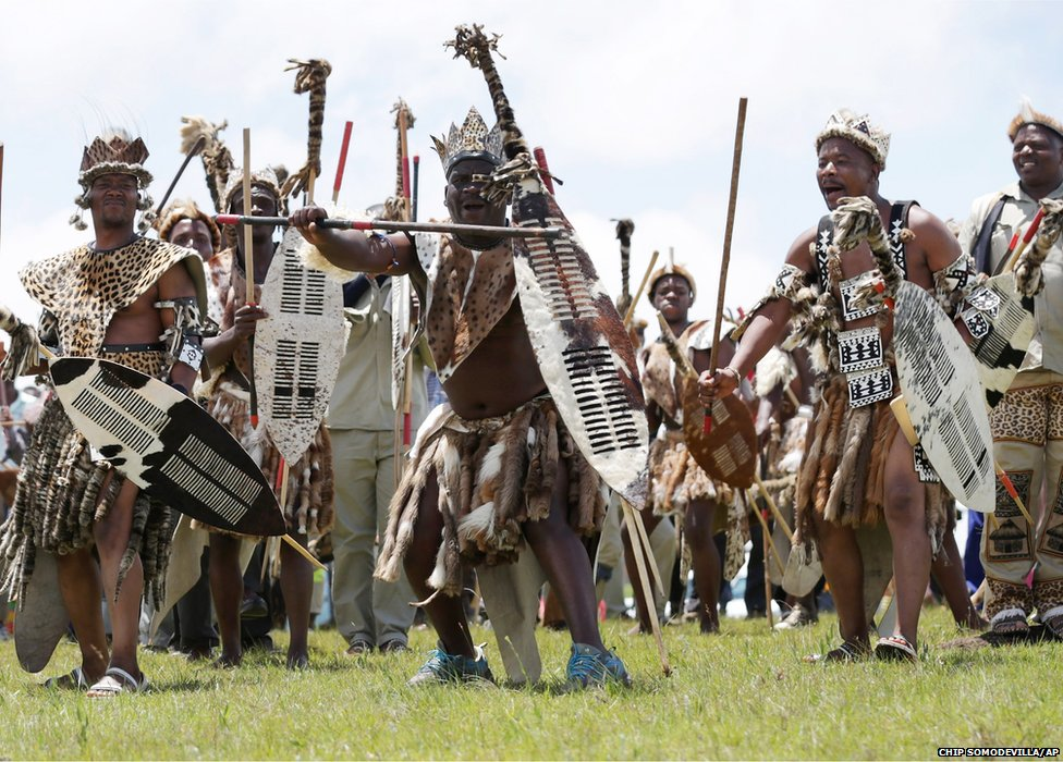 Zulu men perform a traditional dance