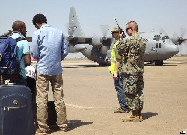A US serviceman uses a radio at Juba's airport, 21 December