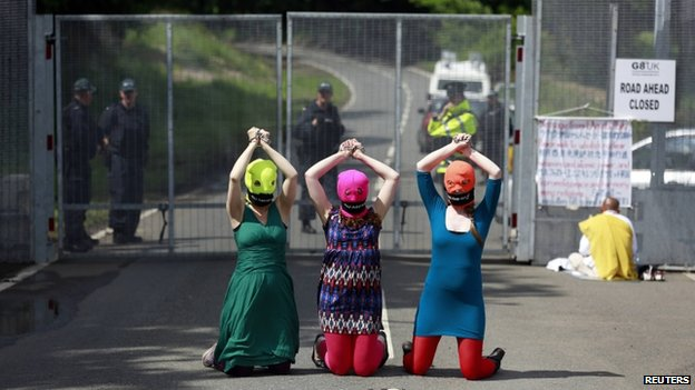 "Demonstrators wear ""Free Pussy Riot"" balaclavas as they protest at the security fence surrounding the G8 Summit at Lough Erne in Enniskillen, Northern Ireland June 17, 2013"