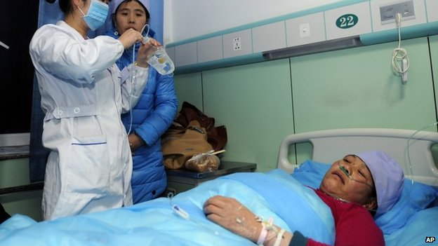 An injured woman receives medical treatment at a hospital in Xiji Town in Guyuan, in Ningxia region, on 7 January 2014