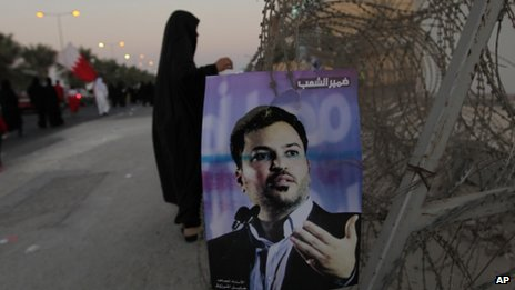 """Arabic writing on the poster reads, """"Conscience of the people,"""" with a picture of jailed opposition figure Khalil Marzooq in Manama, Bahrain (September 2013)"""