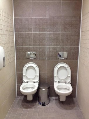 Twin toilets in a men's cubicle at Sochi's Olympic Biathlon Centre