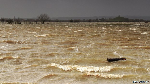 Brown water flood with crested waves