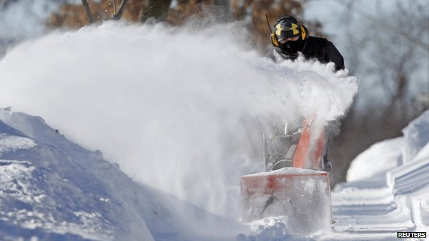 A man used a snow blower in Minneapolis, Minnesota, on 27 January 2014