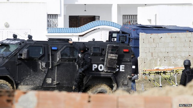 Tunisian soldiers stand guard outside a house where militants were holed up.