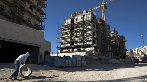 A construction worker works at a site of a new housing unit in the East Jerusalem neighbourhood of Har Homa in November 2011