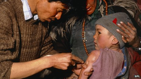 Child being given a measles vaccine in India