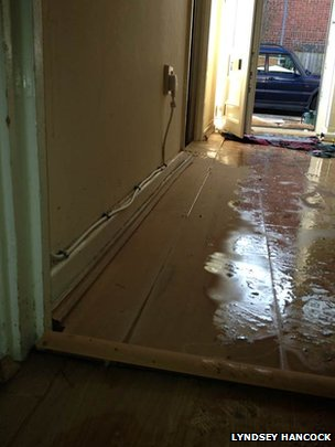 Flooded hallway in Buckinghamshire home