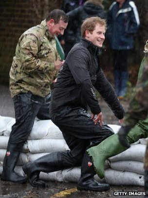 Prince Harry helps with flood defences in the centre of Datchet
