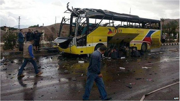 The wreckage of a tourist bus at the site of an explosion in the Egyptian town of Taba