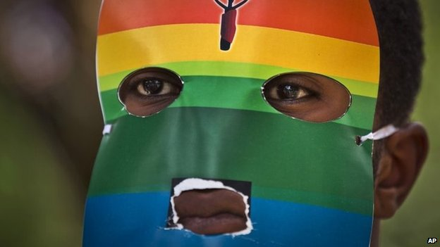A Kenyan gay man wears a mask to preserve his anonymity as he protests against anti-gay moves in Uganda outside the Uganda High Commission in Nairobi, Kenya on 10 February