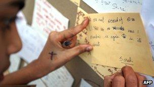 An Indian writes a postcard