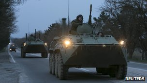 Russian armoured personnel carriers drive on the road from Sevastopol to Simferopol in Crimea.