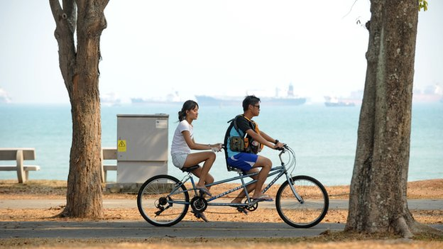 People on bikes in Singapore
