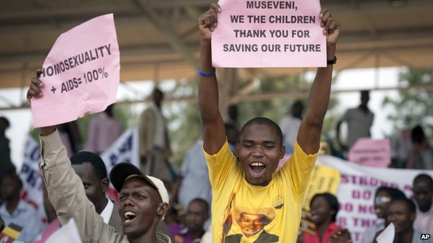 Ugandans supportive of their government's anti-gay stance attend a rally in Kampala on 31 March 2014