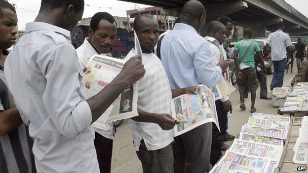 People reading newspapers in Nigeria - 2010